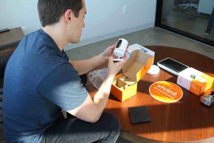 Senior Editor Andrew Garcia unboxing Vivint Ping Indoor Camera