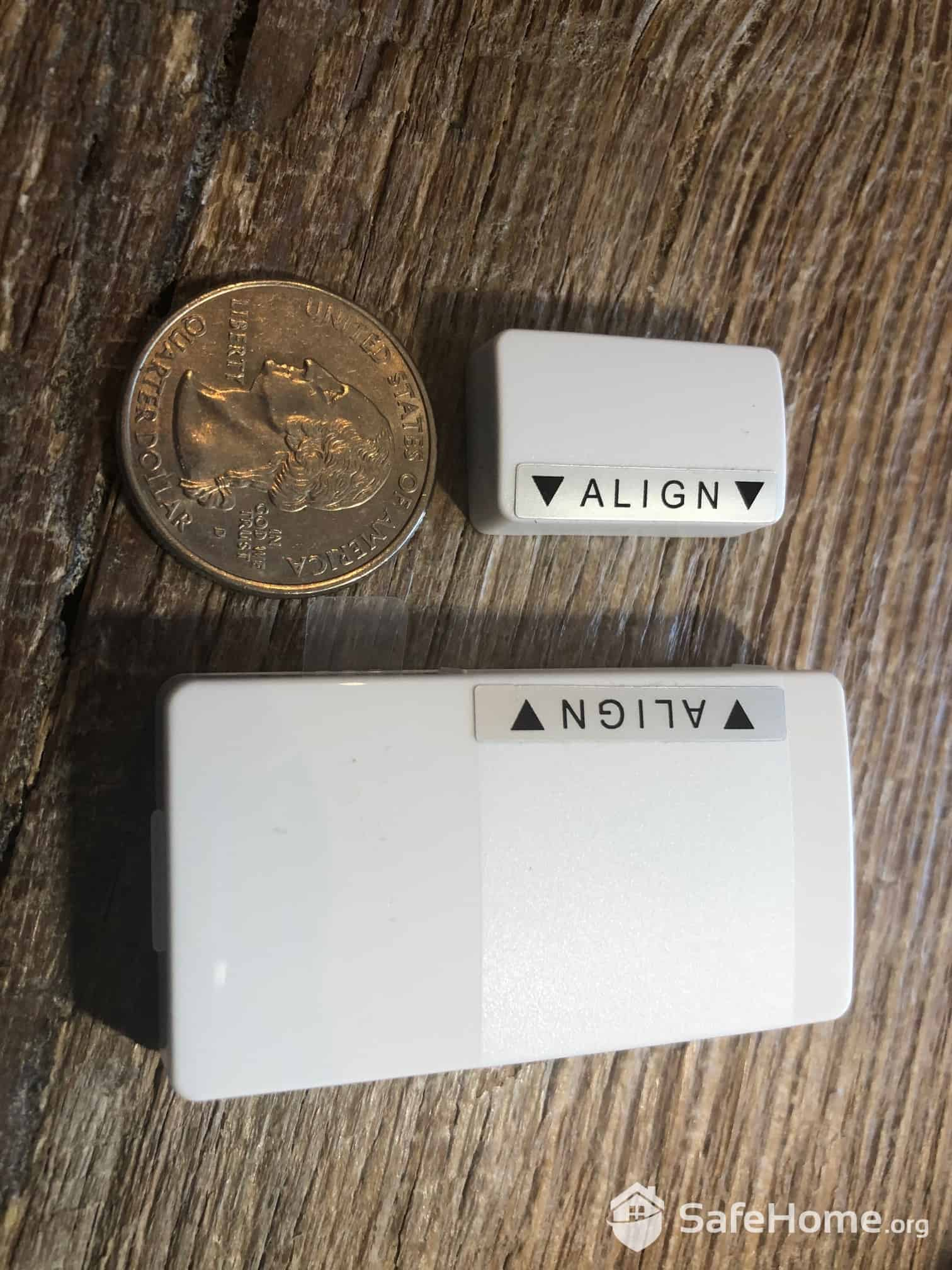 abode Door/Window Sensor Compared to a Quarter