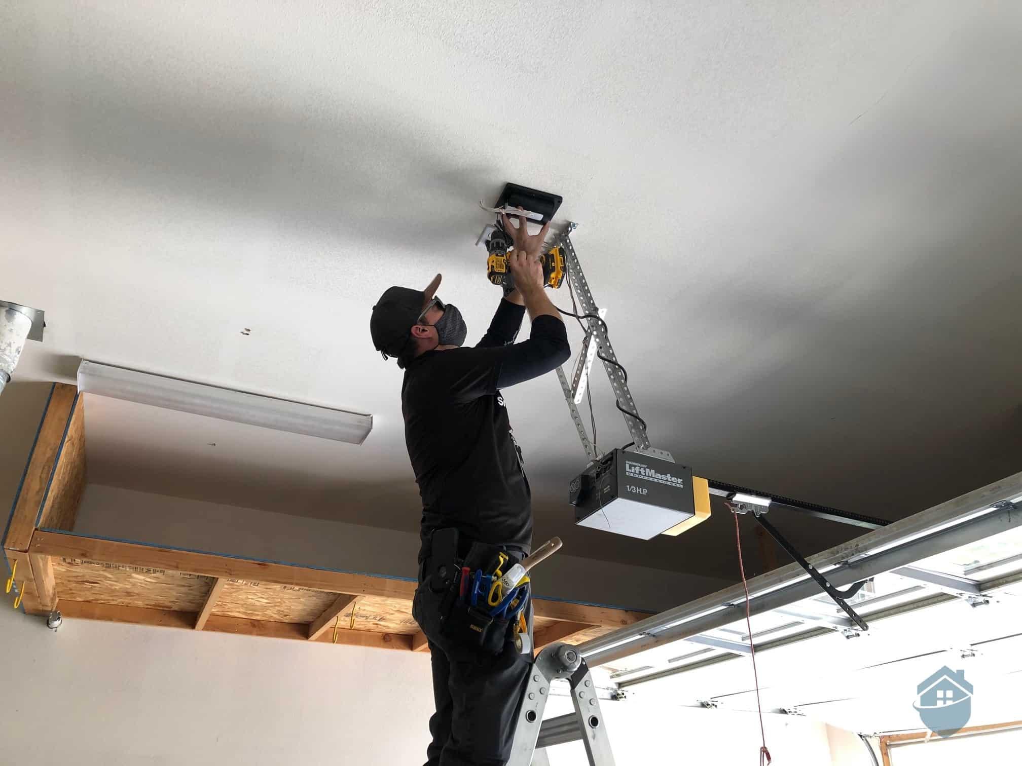 Don, the Vivint Installation Technician, installing our Smart Garage Controller